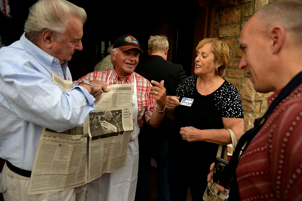 . Mike and Arlene Faybik show Tom Tancredo a photo of Mr. Faybik crying at the Stampede four years ago during Tancredo\'s concession speech. Tancredo said this year he would turn that photo upside down in a proverbial 180-degree twist of fate. Tom Tancredo watch party on Tuesday, June 24, 2014. (Photo by AAron Ontiveroz/The Denver Post)