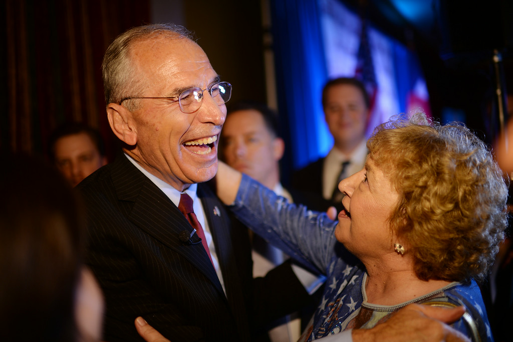 . Bob Beauprez celebrates   winning of race of the Colorado GOP primary for governor with his supporter Karen Fisher at Denver Athletic Club with his family and  supporters. Denver, Colorado. June 24. 2014. (Photo by Hyoung Chang/The Denver Post)