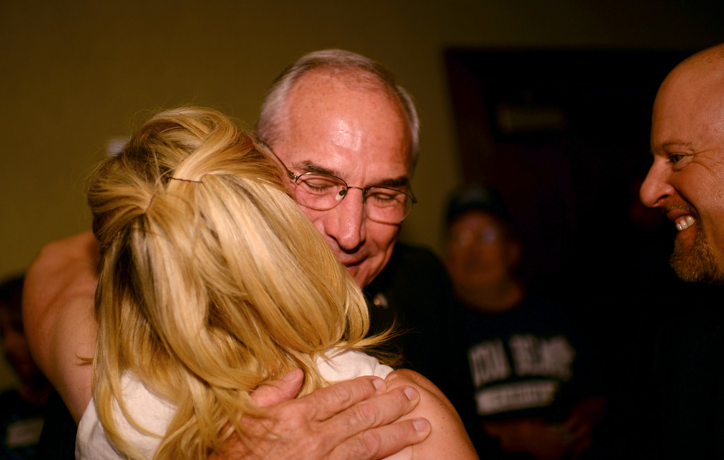 . Gubernatorial candidate Bob Beauprez hugs his supporter Sandra Hagen Solin at the Denver Athletic Club in Denver, Colorado June 24, 2014. Colorado Republicans are choosing among four candidates for a nominee to challenge Democratic Gov. John Hickenlooper. (Photo by Hyoung Chang/The Denver Post)