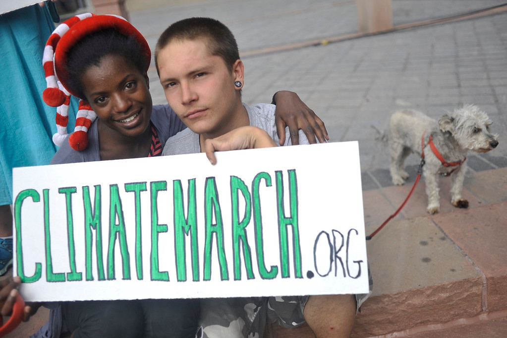 . Lillie Smith and Robert DeFranco, both 19, of Denver hold a sign during The Great March for Climate Action rally on the west steps of the State Capitol in Denver, Colorado on Monday, June 16, 2014. Marchers started March 1, 2014 in Los Angeles with participants aiming to reach Washington DC on foot by Novermber. (Photo By Patrick Traylor/The Denver Post)