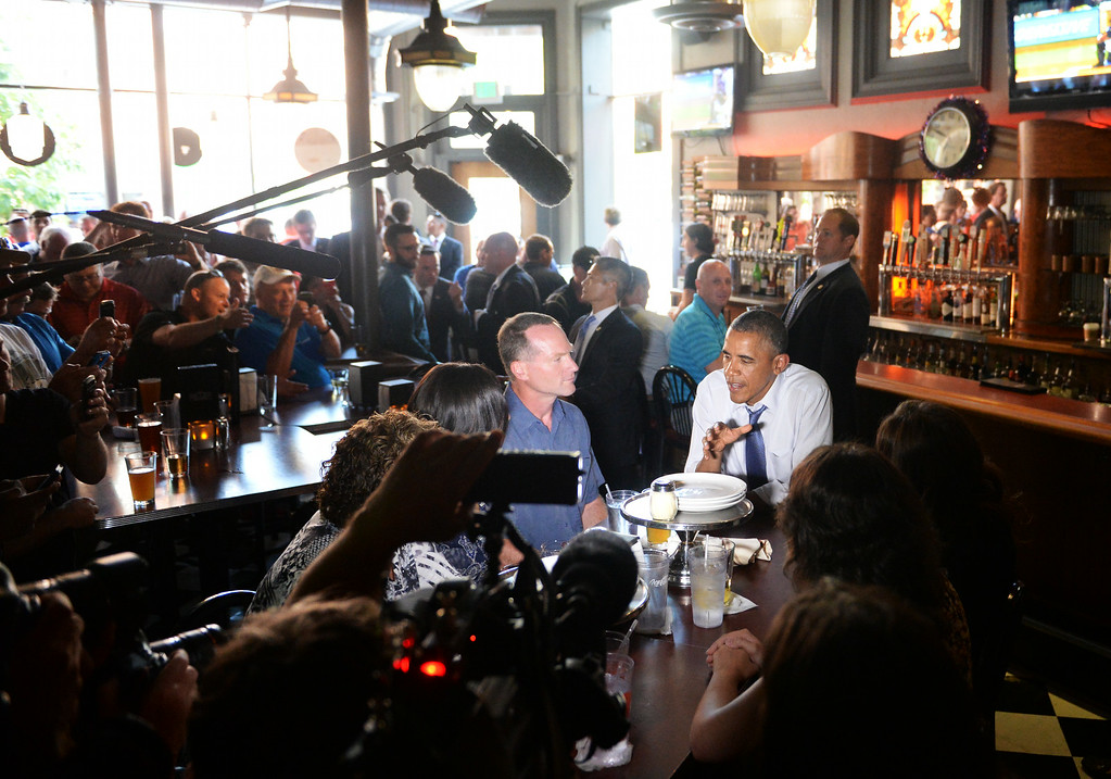 . DENVER, CO - JULY 08: President Barack Obama sits down for dinner, with five individuals who have written to him about the issues that matter most to them and shared stories, at Wazee Supper Club in downtown Denver after arriving in Colorado, July 08, 2014. President Obama is in Colorado to speak about the economy and raise money for Senator Mark Udall\'s re-election campaign. (Photo by RJ Sangosti/The Denver Post)