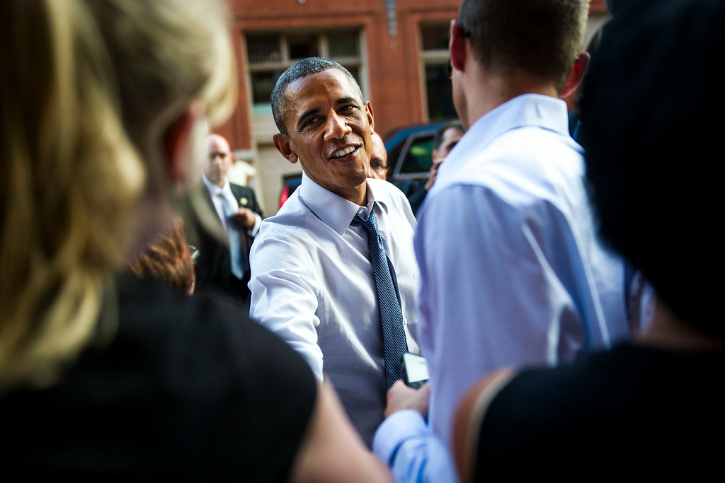 . DENVER, CO - JULY 08:   U.S. President Barack Obama visits with people along 15th Street in downtown Denver after arriving in Colorado, July 08, 2014. President Obama is in Colorado to speak about the economy and raise money for Senator Mark Udall\'s re-election campaign. (Photo by Kent Nishimura/The Denver Post)