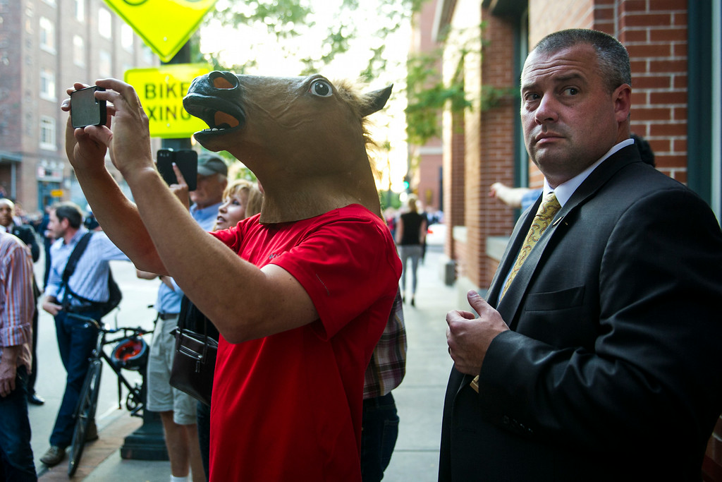 . DENVER, CO - JULY 08:   A Secret Service Agent stands next to a man in a horse mask as President Barack Obama visits with people along 15th Street in downtown Denver after arriving in Colorado, July 08, 2014. President Obama is in Colorado to speak about the economy and raise money for Senator Mark Udall\'s re-election campaign. (Photo by Kent Nishimura/The Denver Post) (Photo by Kent Nishimura/The Denver Post)