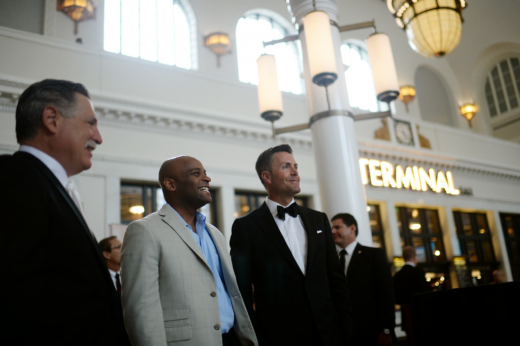 . DENVER, CO - JULY 11: From left, Walter Isenberg of Sage Hospitality, Denver Mayor Michael Hancock and Chad McWhinney are in the Great Hall of Denver Union Station for the Gala in Denver, Colorado July 11, 2014. Union Station is opening with a gala for 1,000 people paying $1,000 each to benefit 55 local charities.(Photo by Hyoung Chang/The Denver Post)