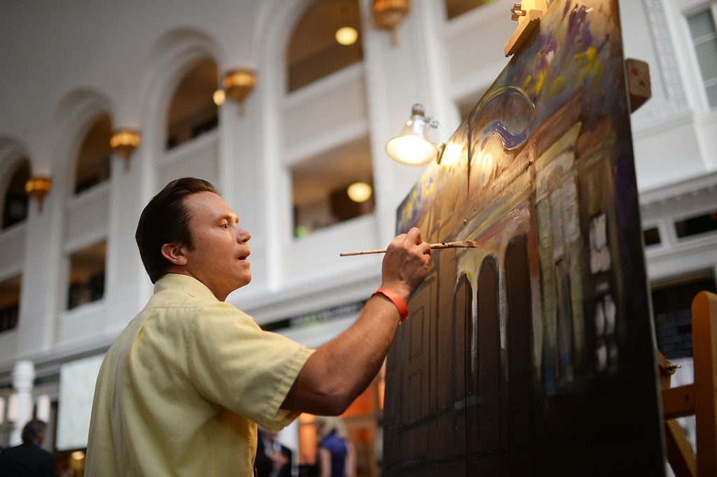 . DENVER, CO - JULY 11: Eric Matelski is live paining for the Denver Union Station Great Hall Gala in Denver, Colorado July 11, 2014. Union Station is opening with the gala for 1,000 people paying $1,000 each to benefit 55 local charities.(Photo by Hyoung Chang/The Denver Post)
