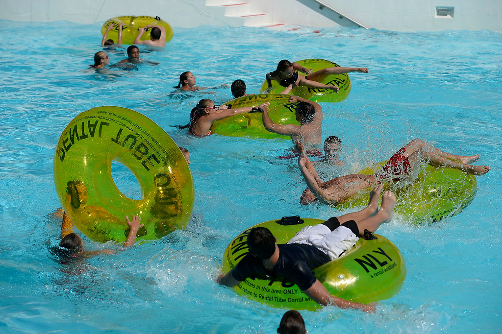 . Lifeguards competed in the Inner Tube Relay at Water World. More than 600 lifeguards proved their life-saving skills as they compete in the 29th Annual Colorado Parks & Recreation Association Lifeguard Games  July 13, 2014 at Hyland Hills Water World. At stake for teams from around the state were bragging rights and of course the individual title of �Colorado�s fastest lifeguard.�  (Photo by John Leyba/The Denver Post)