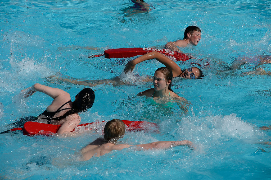 . Lifeguards hit the wave in during the Rescue Tube Relay competition at Water World. More than 600 lifeguards proved their life-saving skills as they competed in the 29th Annual Colorado Parks & Recreation Association Lifeguard Games  July 13, 2014 at Hyland Hills Water World. At stake for teams from around the state were bragging rights and of course the individual title of �Colorado�s fastest lifeguard.�  (Photo by John Leyba/The Denver Post)