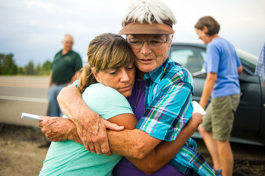 . Dorothy Gibson and Kathleen Stweart hug at a small gathering of Raptor Education Foundation Volunteers at an eagle\'s nest along E120th Avenue near, E-470 on Sunday, July 27, 2014 in Commerce City, Colorado.  (Photo by Kent Nishimura/The Denver Post)