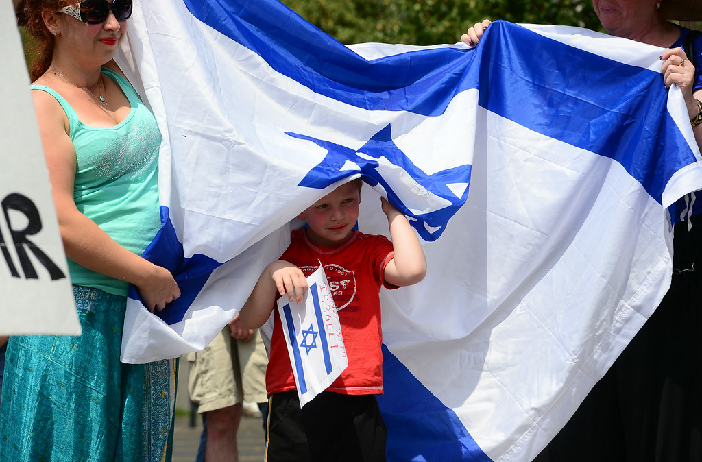 . Emmanuel Paulushkin, 5,  joined his mother Toni, left and grandmother Tatiana, right in hat and a few hundred others  took part in a pro-Israel rally on the west steps of the state Capitol in Denver, CO  on July 27, 2014. (Photo By Helen H. Richardson/ The Denver Post)
