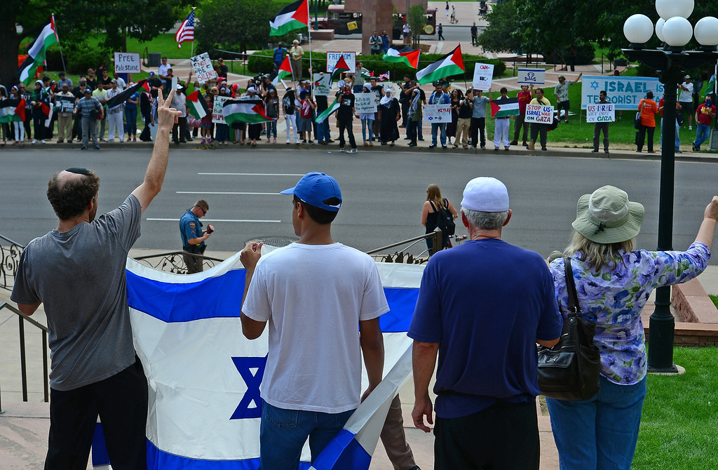 . Pro-Israeli supporters, in foreground, square off against Palestinian supporters on the other side of Broadway during  a pro-Israel rally on the west steps of the state Capitol in Denver, CO  on July 27, 2014. (Photo By Helen H. Richardson/ The Denver Post)