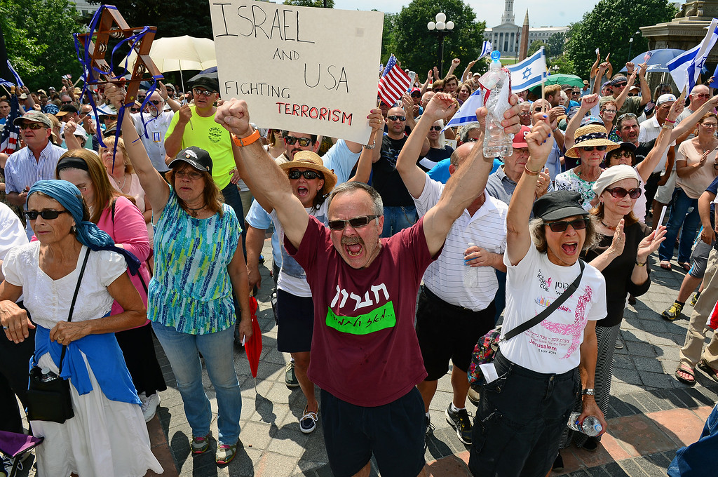 . Craig Schottenstein, with fist in the air, his wife Karen, right, and a few hundred others  took part in a pro-Israel rally on the west steps of the state Capitol in Denver, CO  on July 27, 2014. (Photo By Helen H. Richardson/ The Denver Post)