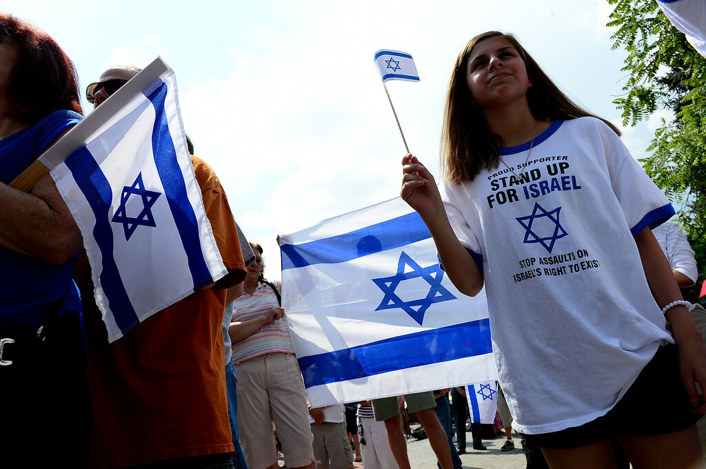 . Janae Herrera, 13, holds an Israeli flag as she and a few hundred others  took part in a pro-Israel rally on the west steps of the state Capitol in Denver, CO  on July 27, 2014. (Photo By Helen H. Richardson/ The Denver Post)