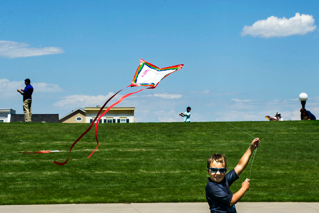 . DENVER, Colorado - AUGUST 06:  Jackson Nunnally, 8, flies a kite he made during the Japanese Kite Festival at the Pavilion at Stapleton Central Park on Wednesday, August 06, 2014 in Denver, Colorado.  The event featured a demonstration by Japanese Kite Master Mikio Toki of Japan and a chance to make your own kites.  (Photo by Kent Nishimura/The Denver Post)