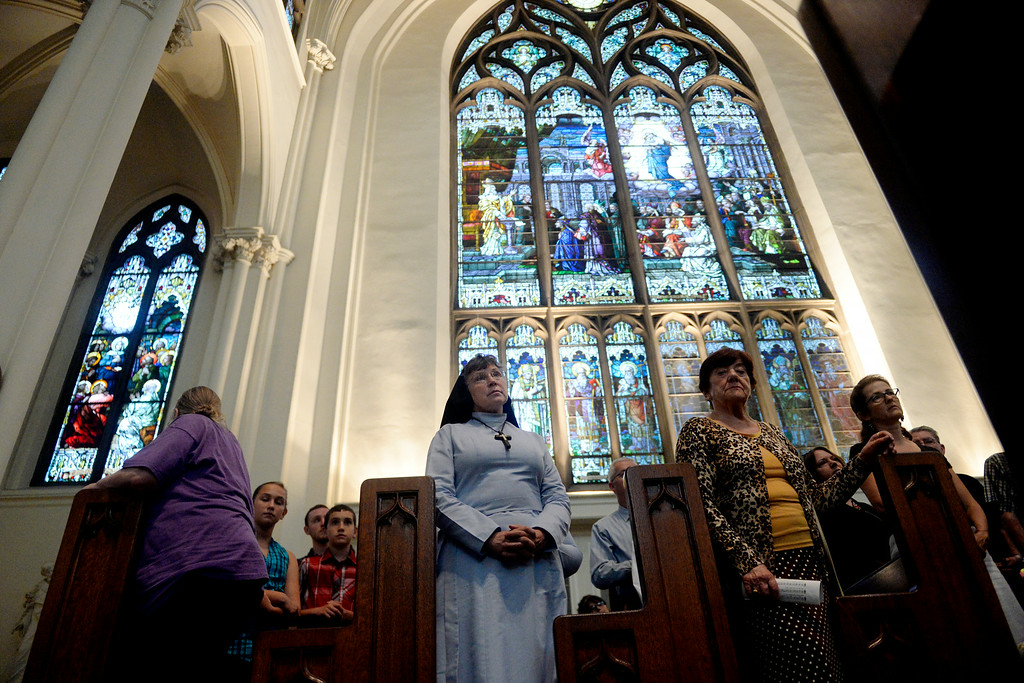 . Sister Esther Nickel (center) prays with people of various faiths during a service for peace. The Place Initiative: Peace, Love and Co-Existence, an inter-faith assembly, was photographed on Monday, August 11, 2014. (Photo by AAron Ontiveroz/The Denver Post)