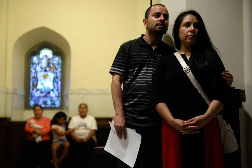 . Benny Carrasco and Antonia Rosales listen as various religious leaders lead a group of people in prayer and peace during an inter-faith gathering. The Place Initiative: Peace, Love and Co-Existence, an inter-faith assembly, was photographed on Monday, August 11, 2014. (Photo by AAron Ontiveroz/The Denver Post)