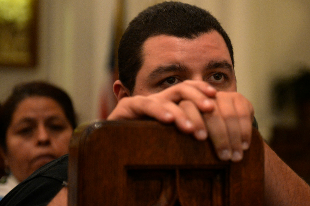 . Craig Soto II listens as various religious leaders speak and lead a group in prayer. The Place Initiative: Peace, Love and Co-Existence, an inter-faith assembly, was photographed on Monday, August 11, 2014. (Photo by AAron Ontiveroz/The Denver Post)