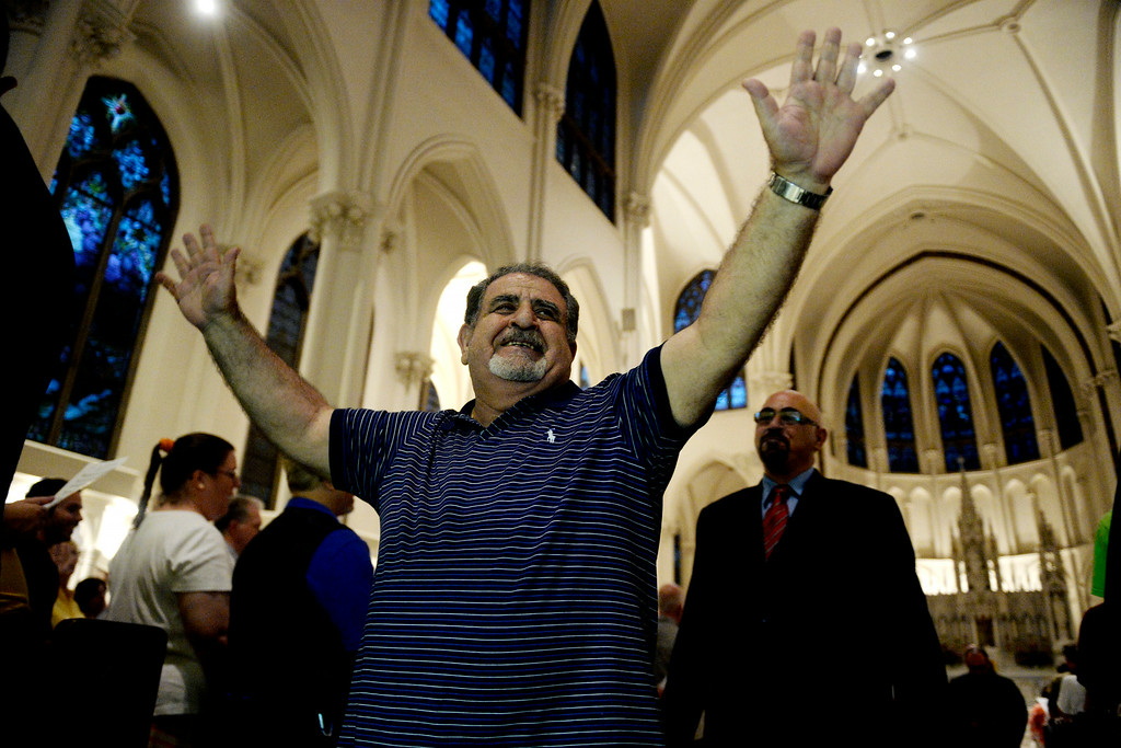 . Dr. Elias Naoum of Syriac Orthodox Church waves to the crowd as the ceremony ends. The Place Initiative: Peace, Love and Co-Existence, an inter-faith assembly, was photographed on Monday, August 11, 2014. (Photo by AAron Ontiveroz/The Denver Post)