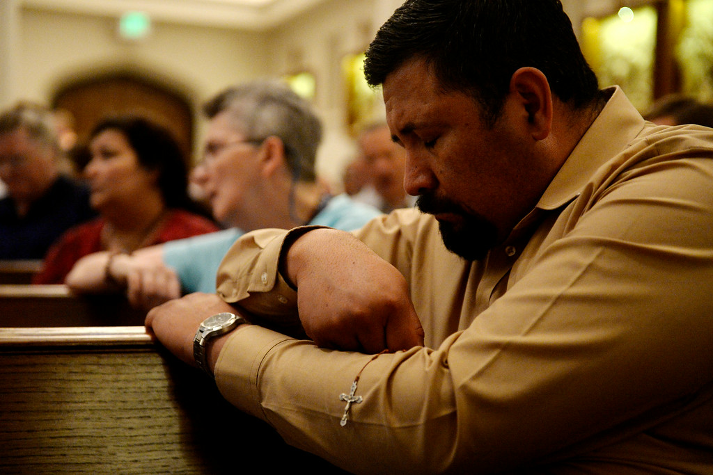 . Abram Leon bows his head in prayer during an inter-faith gathering. The Place Initiative: Peace, Love and Co-Existence, an inter-faith assembly, was photographed on Monday, August 11, 2014. (Photo by AAron Ontiveroz/The Denver Post)