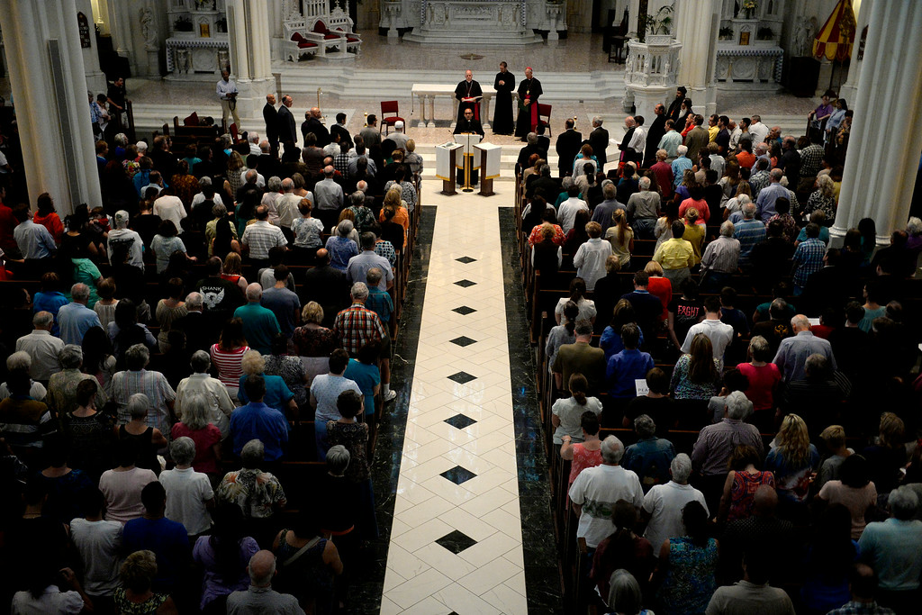 . Various religious leaders lead a group of people in prayer and peace during an inter-faith gathering. The Place Initiative: Peace, Love and Co-Existence, an inter-faith assembly, was photographed on Monday, August 11, 2014. (Photo by AAron Ontiveroz/The Denver Post)