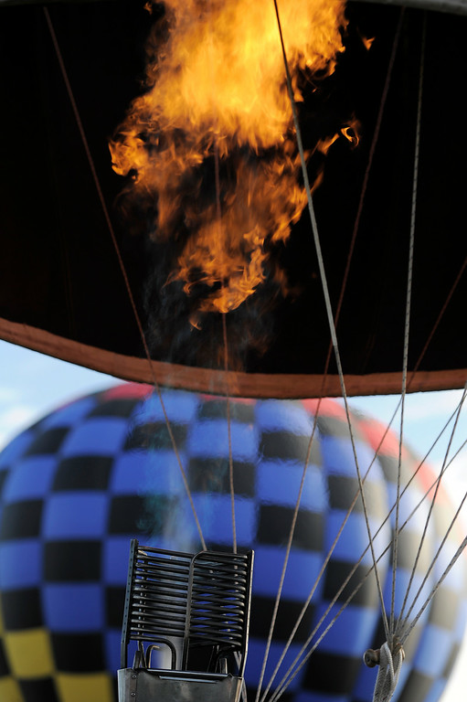 . Burners fill the balloon with hot air as hundreds of balloon enthusiasts gather to watch the launch of The 2014 Colorado Balloon Classic at Memorial Park in Colorado Springs. (Photo by John Leyba/The Denver Post)