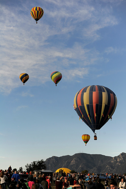 . Hundreds of balloon enthusiasts gather to watch the launch of The 2014 Colorado Balloon Classic in its 38th Year August 31, 2014 at Memorial Park. (Photo by John Leyba/The Denver Post)