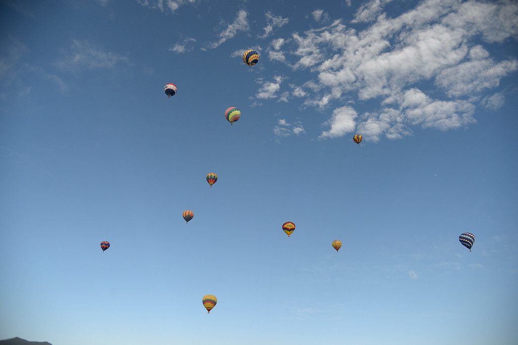 . Hot Air Balloons fill the sky high above as hundreds of balloon enthusiasts gather to watch the launch of The 2014 Colorado Balloon Classic on Sunday August 31, 2014 at Memorial Park. (Photo by John Leyba/The Denver Post)