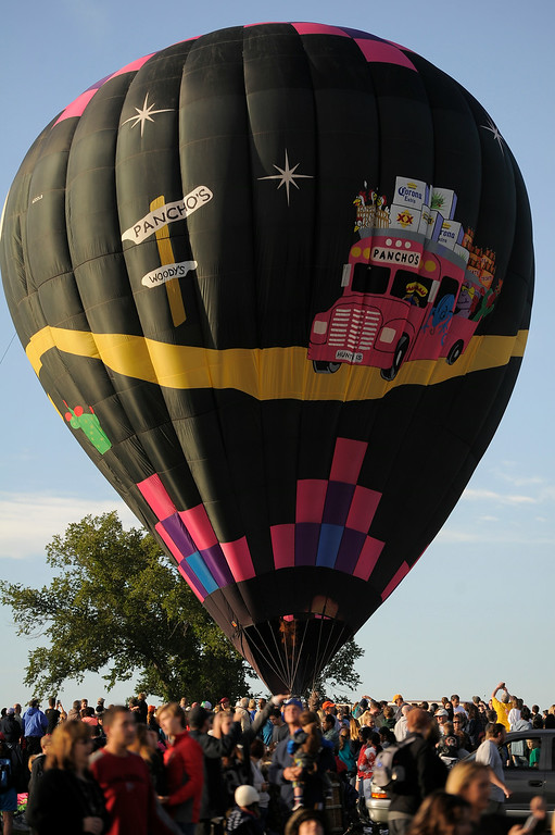 . Hundreds of balloon enthusiasts gather to watch the launch of The 2014 Colorado Balloon Classic at Memorial Park. This is the last year this balloon festival will be held in Colorado Springs.  (Photo by John Leyba/The Denver Post)