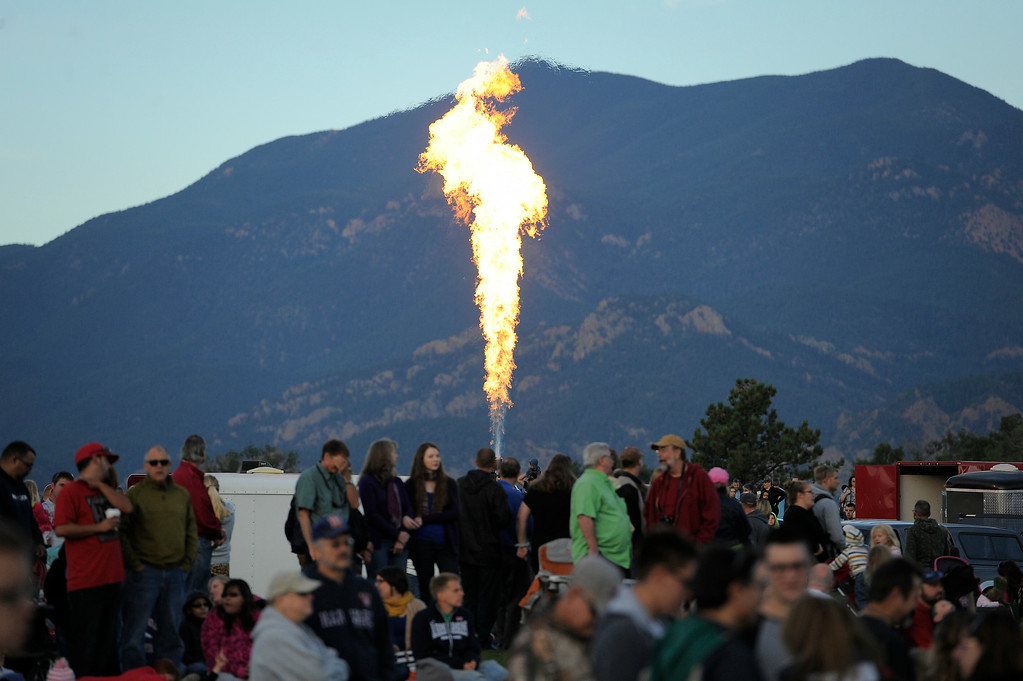 . Balloonist fire up the engines as they pre to launch their balloons during The 2014 Colorado Balloon Classic in its 38th Year on Sunday, August 31, 2014 at Memorial Park in Colorado Springs. (Photo by John Leyba/The Denver Post)