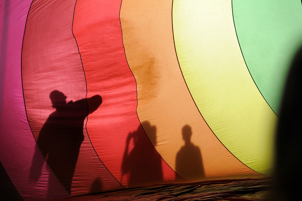 . Shadows cast on the balloon while crews use a gasoline powered inflator fan used to fill the balloon envelope with cold air as it lays on the ground.  (Photo by John Leyba/The Denver Post)