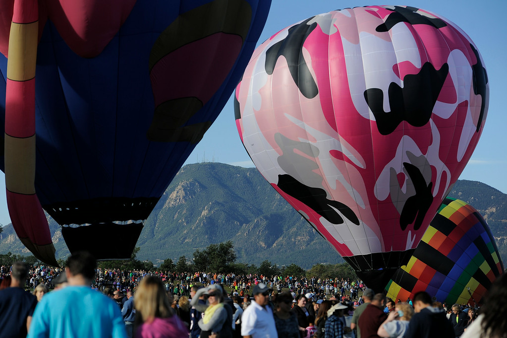 . Hundreds of balloon enthusiasts gather to watch the launch of The 2014 Colorado Balloon Classic in its 38th Year on Sunday, August 31, 2014, at Memorial Park. This is the last year this balloon festival will be held in Colorado Springs. (Photo by John Leyba/The Denver Post)