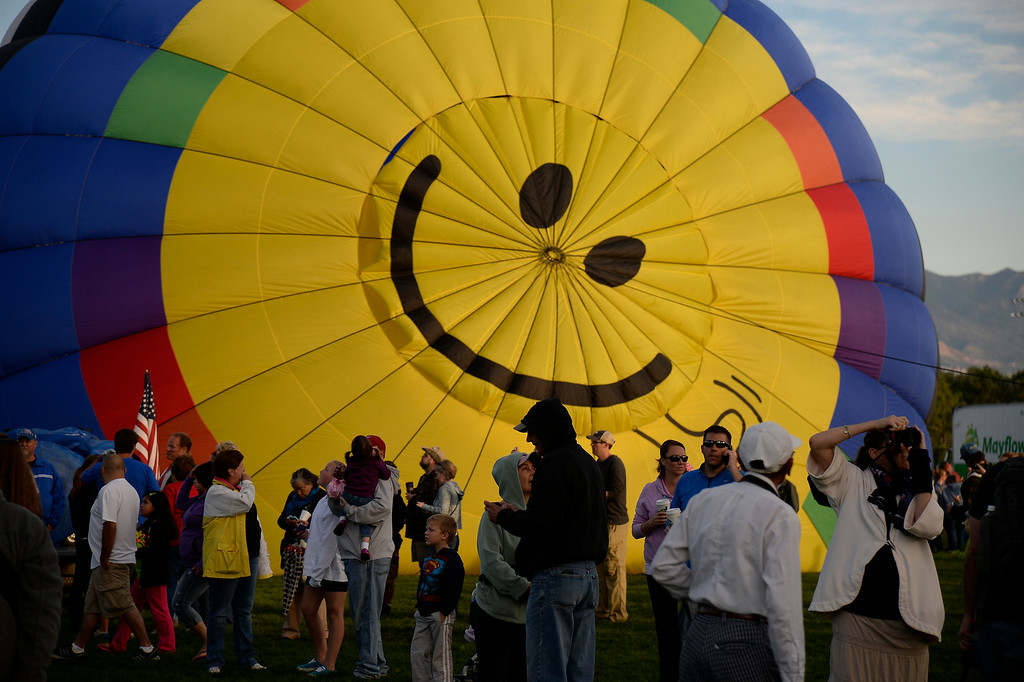 . Hundreds of balloon enthusiasts gather to watch the launch of The 2014 Colorado Balloon Classic in its 38th Year on Sunday, August 31, 2014, at Memorial Park. This is the last year this balloon festival will be held in Colorado Springs. It has been Colorado�s largest hot air balloon festival and the State�s largest airshow for 38 years. (Photo by John Leyba/The Denver Post)