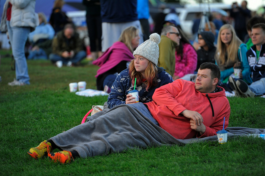 . Zachary Ruth, 22, and Christina Ruth, 22, stake claim on the lawn as they attend The 2014 Colorado Balloon Classic in its 38th Year at Memorial Park in Colorado Springs. (Photo by John Leyba/The Denver Post)