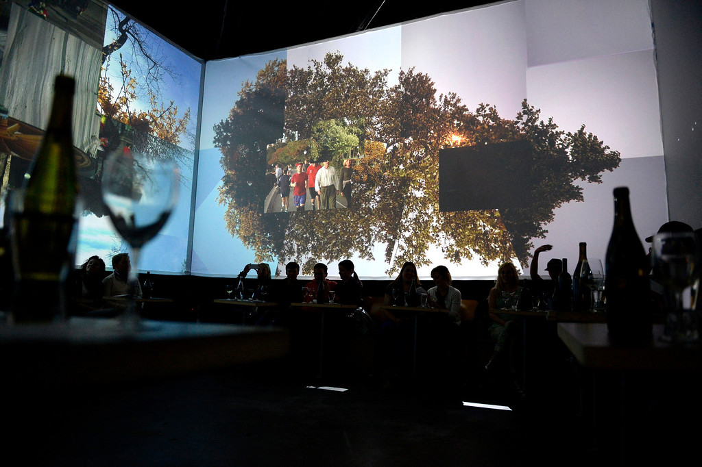 . Patrons dine as they watch the films projected on the dining area\'s containing cube during an evening at Monkey Town at 35th and Larimer. Patrons enjoy a five-course meal at Monkey Town on Sunday, March 9, 2014. (Photo By AAron Ontiveroz/ The Denver Post)