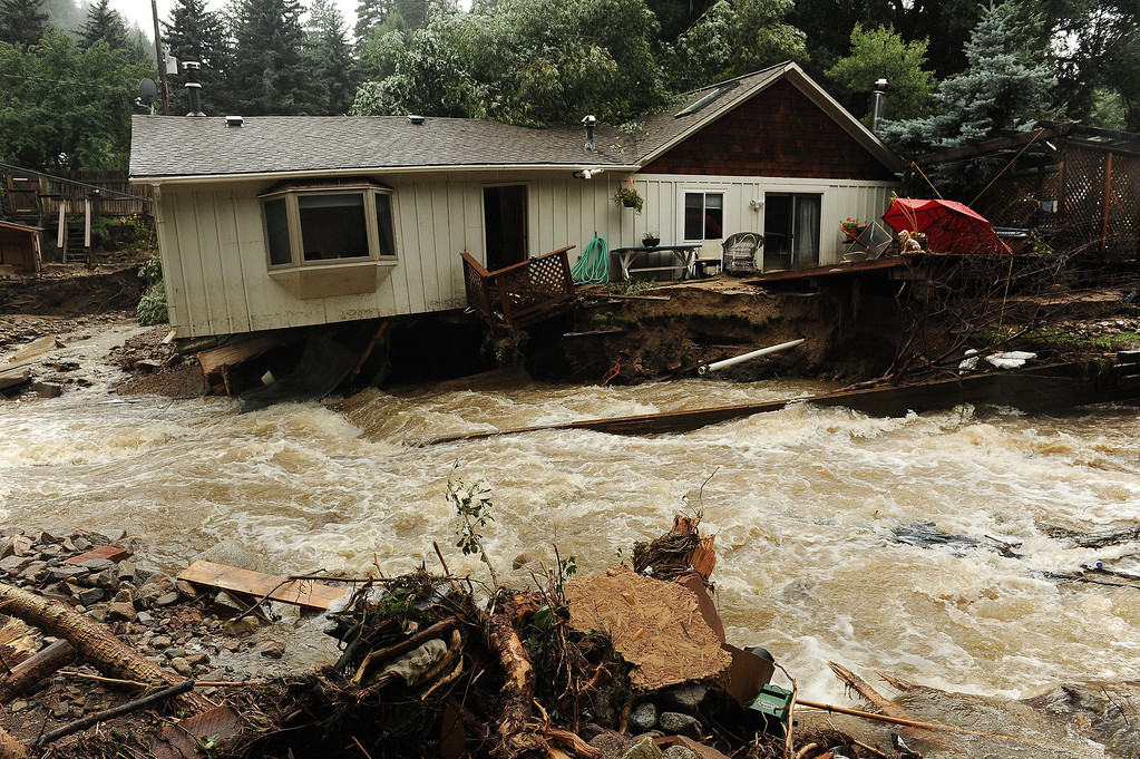. What looks like a river in fact used to be the front and back yards of the residents of these homes  in Jamestown, CO on September 15, 2013.  People in the town say the the Little Jim Creek which used to flow quietly through town has changed course and is tearing apart properties and houses as it continues to rage. (Photo By Helen H. Richardson/ The Denver Post)