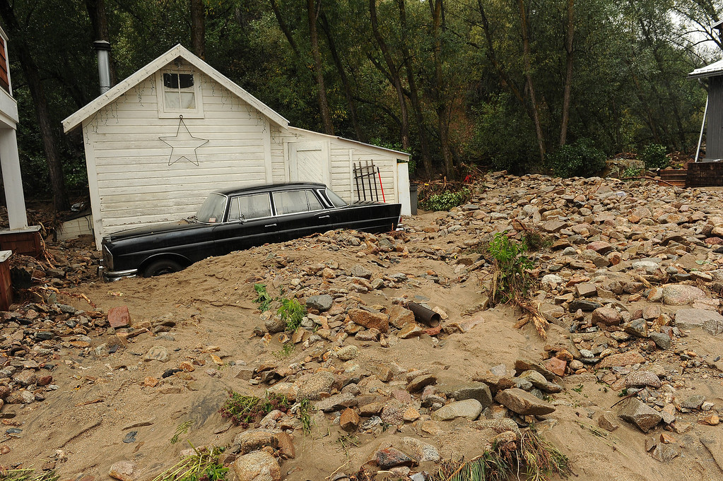. An old black Mercedes  lays buried in the debris in Jamestown, CO on September 15, 2013.   The town has been completely destroyed from the recent floods. The town has no infrastructure or running water.  Some parts of town amazingly enough have electricity.  (Photo By Helen H. Richardson/ The Denver Post)