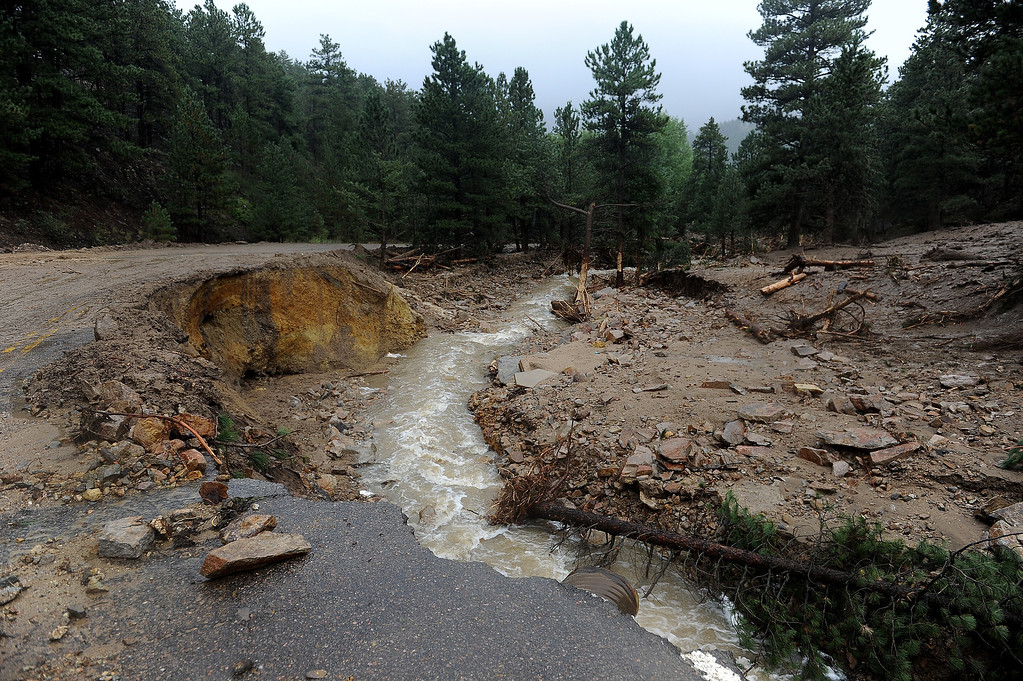 . The floods have taken out huge portions of James Canyon Drive east and west of Jamestown, CO on September 15, 2013.  This perspective is west of town.  People in the town say the the Little Jim Creek which used to flow quietly through town has changed course and is tearing apart properties and houses as it continues to rage. (Photo By Helen H. Richardson/ The Denver Post)