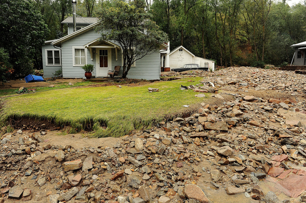. A green lawn and a quaint house lay amongst the debris in Jamestown, CO on September 15, 2013.   The town has been completely destroyed from the recent floods. The town has no infrastructure or running water.  Some parts of town amazingly enough have electricity.   (Photo By Helen H. Richardson/ The Denver Post)