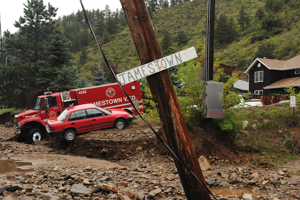 . An engine from Jamestown Fire Department and another car, are casualties to the flood  in Jamestown, CO on September 15, 2013.   The town has been completely destroyed from the recent floods. (Photo By Helen H. Richardson/ The Denver Post)