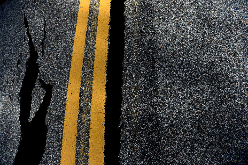 . PINEWOOD SPRINGS, CO - SEPTEMBER 22: A crack in the pavement near a ledge of roadway during a tour to look at the damage caused by recent flooding in the area on U.S. Highway 36 between Lyons and Pinewood Springs. Pavement is missing in many section of the road that connects Lyons to Estes Park. (Photo by AAron Ontiveroz/The Denver Post)
