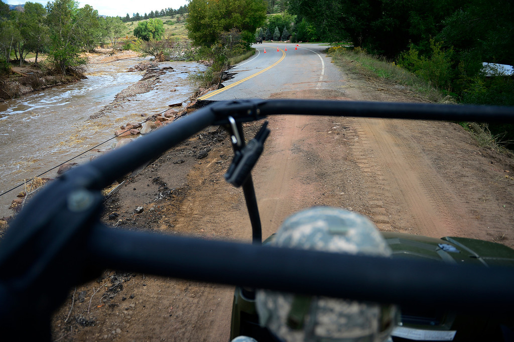 . Sgt. First Class David Yows drives a multipurpose vehicle during a tour to look at the damage caused by recent flooding in the area on U.S. Highway 36 between Lyons and Pinewood Springs. Pavement is missing in many section of the road that connects Lyons to Estes Park. (Photo by AAron Ontiveroz/The Denver Post)