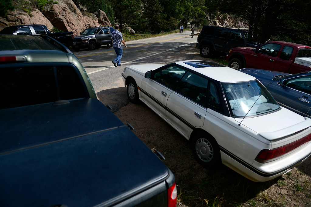 . PINEWOOD SPRINGS, CO - SEPTEMBER 22: A broken section of road near where nearly two dozen cars were parked for residents to get in and out of the Pinewood Springs area during a tour to look at the damage caused by recent flooding in the area on U.S. Highway 36 between Lyons and Pinewood Springs. Pavement is missing in many section of the road that connects Lyons to Estes Park. (Photo by AAron Ontiveroz/The Denver Post)