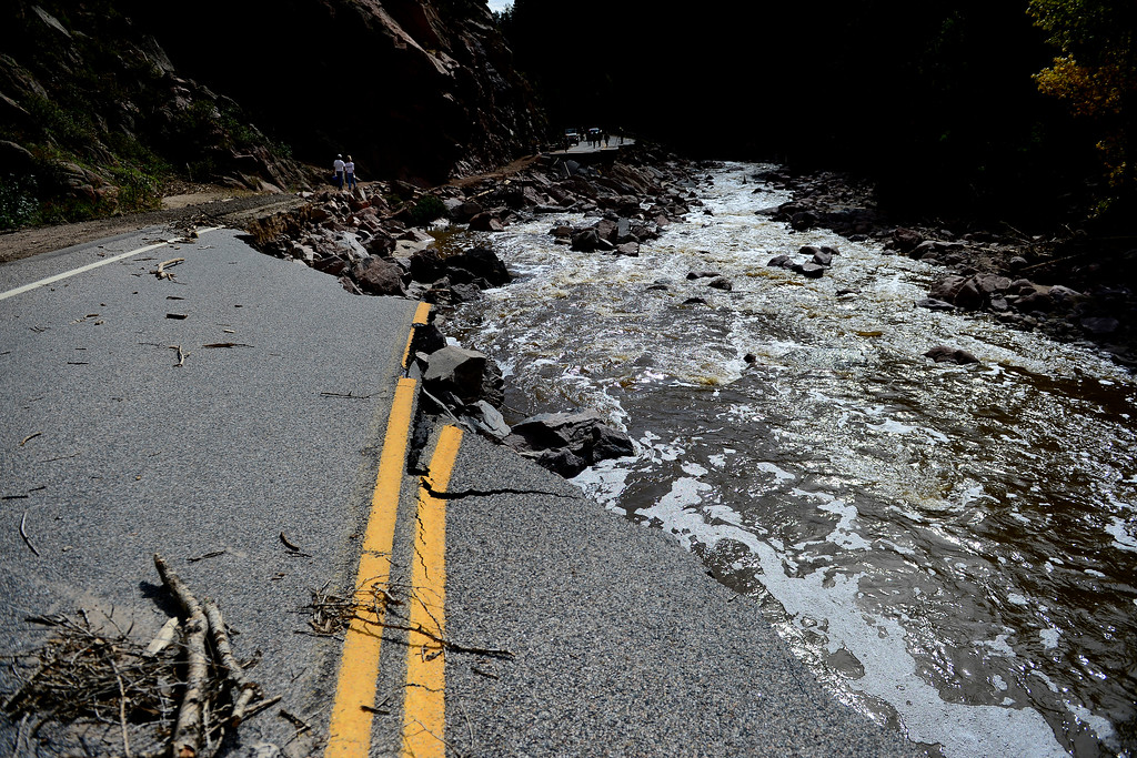 . PINEWOOD SPRINGS, CO - SEPTEMBER 22: A broken section of road near Pinewood Springs during a tour to look at the damage caused by recent flooding in the area on U.S. Highway 36 between Lyons and Pinewood Springs. Pavement is missing in many section of the road that connects Lyons to Estes Park. (Photo by AAron Ontiveroz/The Denver Post)