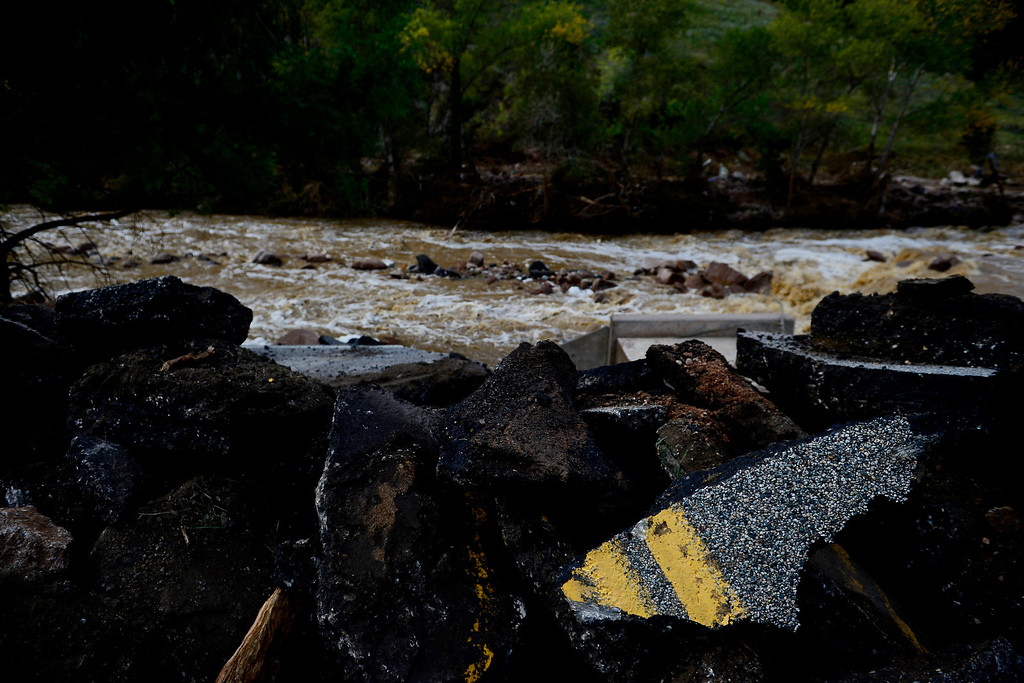 . Chunks of asphalt lie in a broken pile during a tour to look at the damage caused by recent flooding in the area on U.S. Highway 36 between Lyons and Pinewood Springs. Pavement is missing in many section of the road that connects Lyons to Estes Park. (Photo by AAron Ontiveroz/The Denver Post)