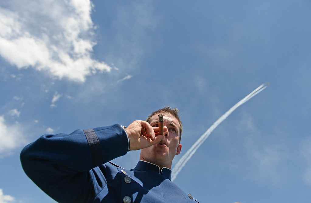 . Cadet Erik Schweiss celebrates after the commencement ceremony at Air Force Academy in Colorado Spring, May 28, 2014. (Photo by RJ Sangosti/The Denver Post)