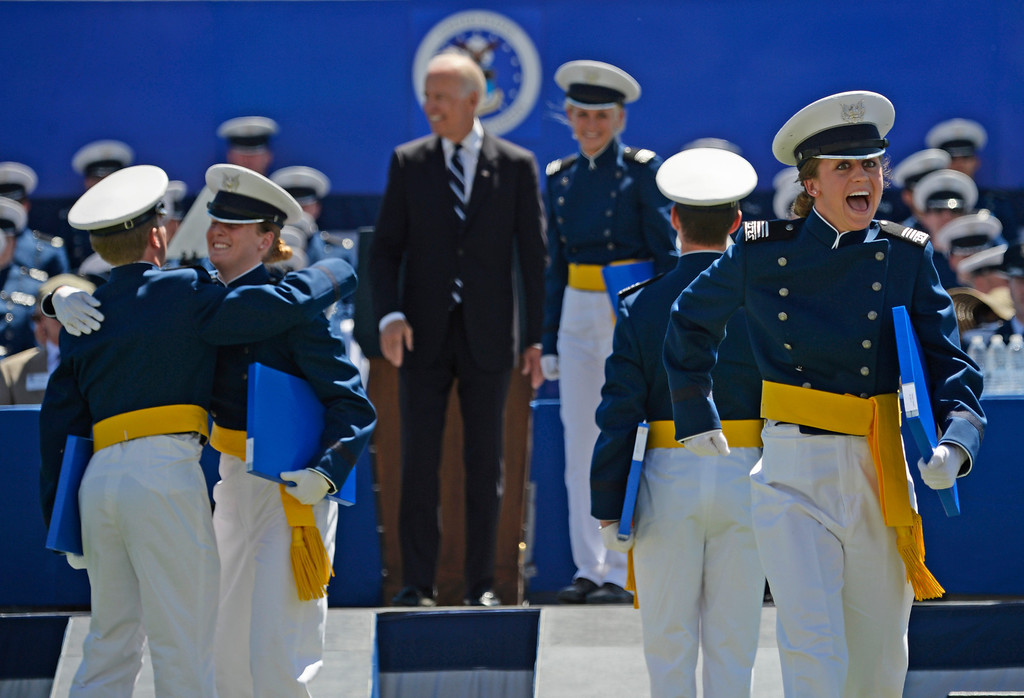 . Cadets receive their diplomas as Vice President of the United States Joe Biden greets them during the commencement ceremony at Air Force Academy in Colorado Spring, May 28, 2014. (Photo by RJ Sangosti/The Denver Post)