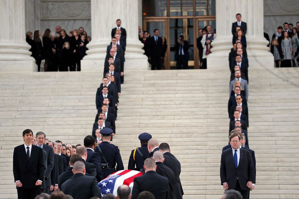 . The body of Justice Antonin Scalia arrives at the Supreme Court in Washington, Friday, Feb. 19, 2016. Thousands of mourners will pay their respects Friday for Justice Antonin Scalia as his casket rests in the Great Hall of the Supreme Court, where he spent nearly three decades as one of its most influential members. (AP Photo/Alex Brandon)