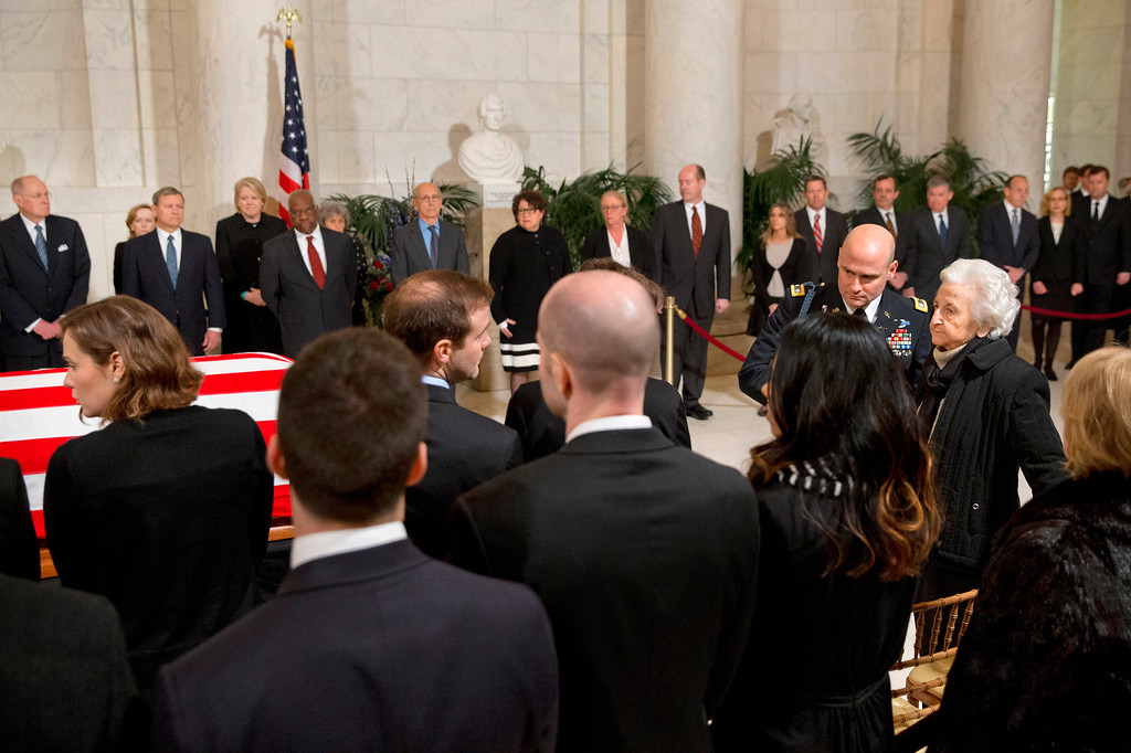 . Members of the Scalia family are escorted to their seats as they arrive for a private ceremony in the Great Hall of the Supreme Court in Washington, Friday, Feb. 19, 2016, where late Supreme Court Justice Antonin Scalia lies in repose. (AP Photo/Jacquelyn Martin, Pool)