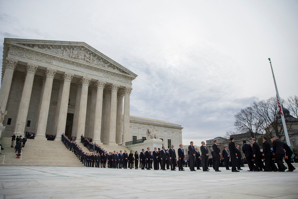 . The body Supreme Court Justice Antonin Scalia arrives at the Supreme Court in Washington, Friday, Feb. 19, 2016. Thousands of mourners will pay their respects Friday for Justice Antonin Scalia as his casket rests in the Great Hall of the Supreme Court, where he spent nearly three decades as one of its most influential members. (AP Photo/Evan Vucci)