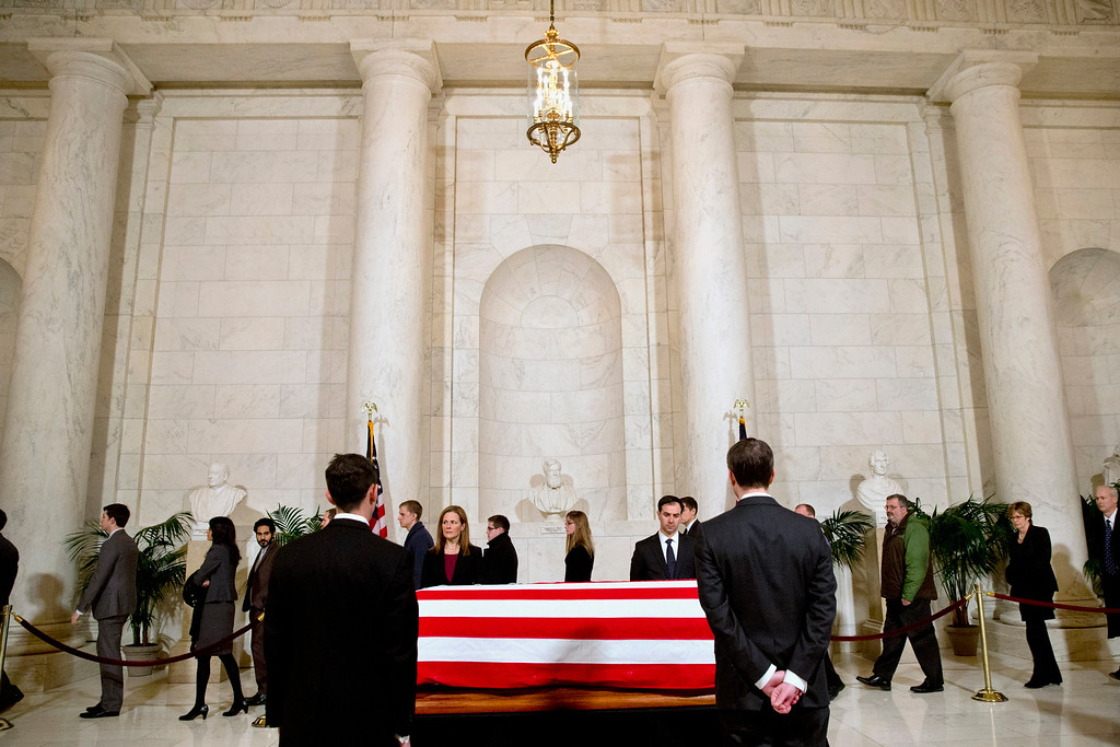 . Supreme Court staff attend a private visitation in the Great Hall of the Supreme Court in Washington, Friday, Feb. 19, 2016, where late Supreme Court Justice Antonin Scalia lies in repose. (AP Photo/Jacquelyn Martin, Pool)