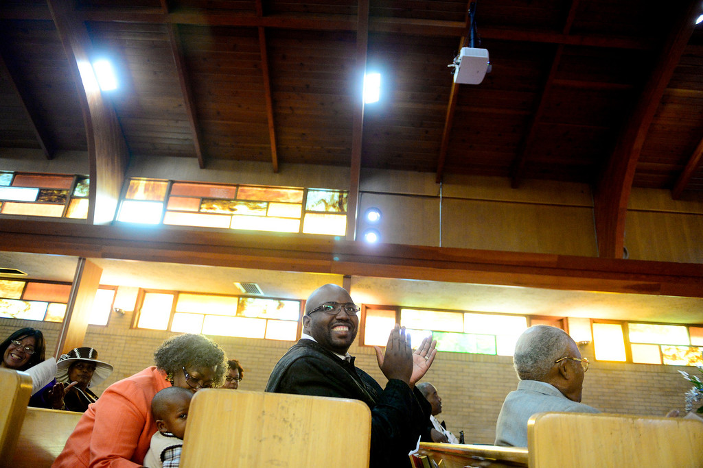. Pastor Victor-LaMonte Lane sings along with fellow parishioners during a Sunday service at Macedonia Baptist church in Denver on November 24, 2013. Lane was installed as the new pastor of the church on December 6, 2013. (Photo by AAron Ontiveroz/The Denver Post)